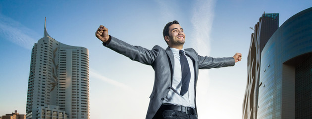 Successful businessman with his arms wide open