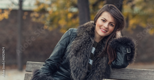 Young attractive woman wearing fur