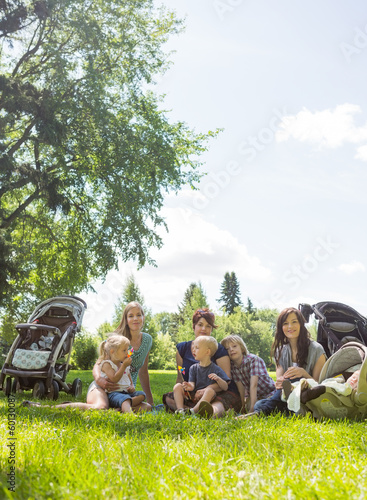 Female Friends With Their Children Enjoying Picnic