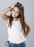 Young latino girl posing in studio poster