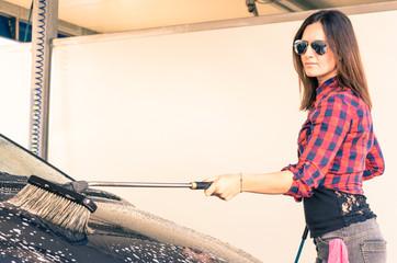 Woman at car wash Station