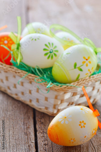 easter basket on wooden board