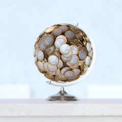 Globe Made Up Of Euro Coins On Wooden Surface