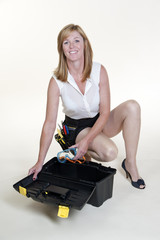 Woman wearing short skirt and long legs with toolbox