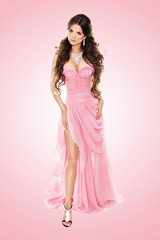 Beauty fashionable woman in elegant pink dress isolated over pin