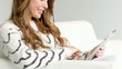 Beautiful Girl Sitting on Couch and Playing With Touchpad