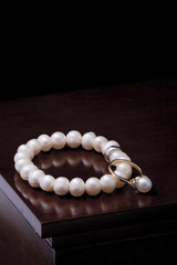 Ring with pearl and pearl bracelet
