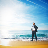 Fototapety businessman on a beach