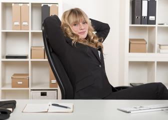Businesswoman relaxing sat her desk