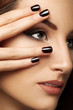 Beautiful Woman With Black Nails. Makeup and Manicure.