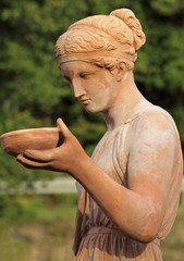 woman carrying dish - classic sculpture