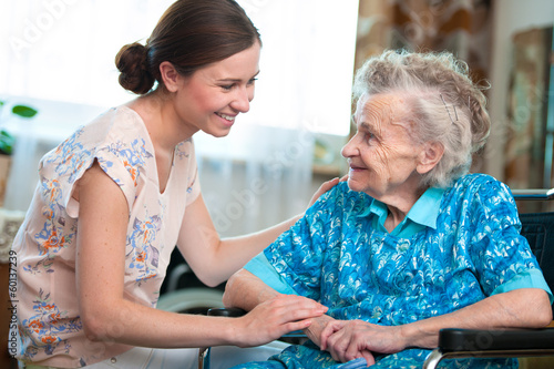 Leinwanddruck Bild senior woman with her home caregiver