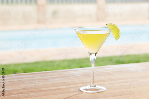 Classic daiquiri cocktail by a pool outdoors