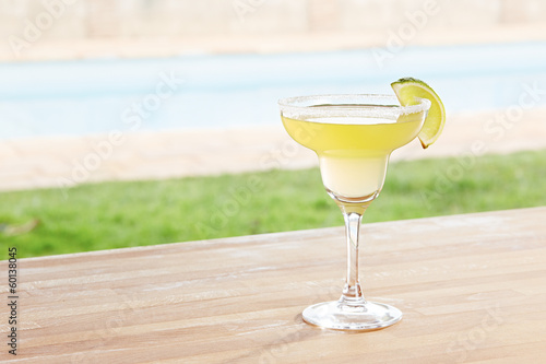 Margarita cocktail by a pool outdoors