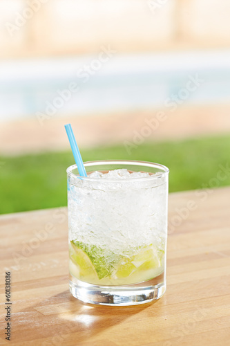 Classic caipirinha cocktail by a pool outdoors