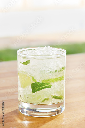 Classic mojito cocktail by a pool outdoors