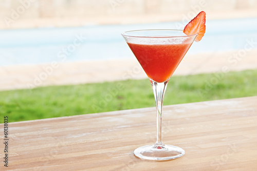 Strawberry daiquiri cocktail by a pool outdoors