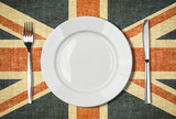Plate, knife and fork over british flag canvas