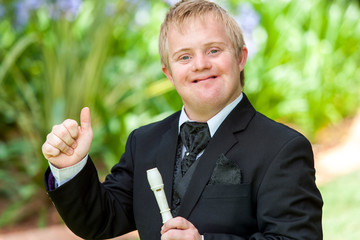 Disabled musician doing thumbs up.