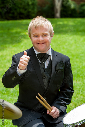 Handicapped drummer showing thumbs up.