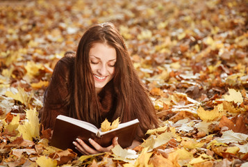 young female reading book