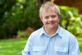 Smiling handicapped boy outdoors. - Fine Art prints