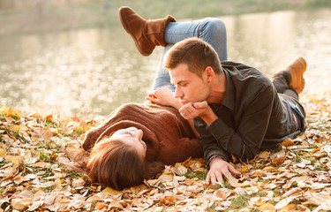 young couple lying down outdoors