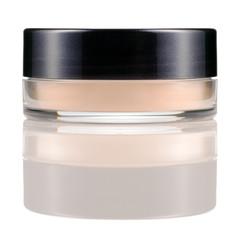 Translucent loose powder in a jar.