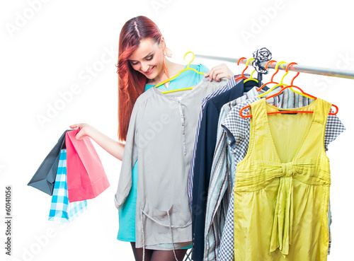Shopaholic young woman choosing clothes