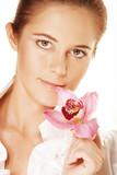 beautiful woman holding pink flower