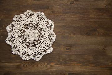 Crochet doily overdark  wood