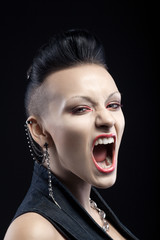 portrait of angry young woman screaming isolated on black backgr