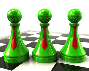 Three green pawns with red neckties