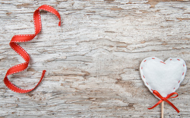 Valentine background  with textile heart on old wood