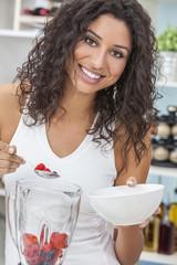 Woman Making Fruit Smoothie in Kitchen