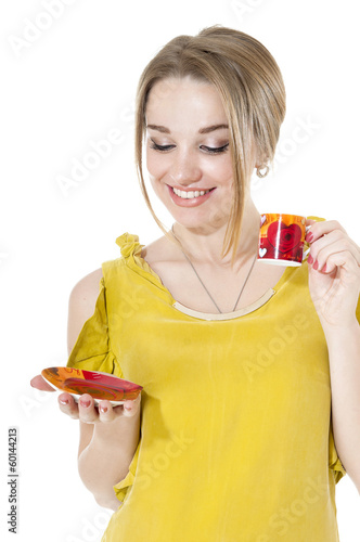 Smiling woman with cup of coffee on a plate, isolated on white b