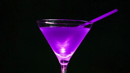 lilac  cocktail. Wine  glass in rotation