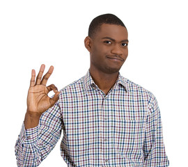Friendly young man showing ok sign
