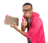 Excited, happy student holding books, showing thumbs up