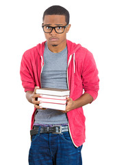 Stressed male student holding books, anxious of exams