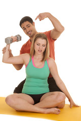 woman sit man behind point to weight