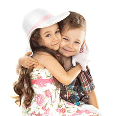 little boy and girl hugging isolated over white