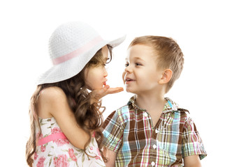 little girl kissing boy isolated over white
