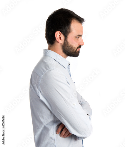 Men with his arms crossed over isolated background
