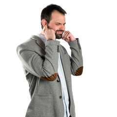 business man covering his ears over white background