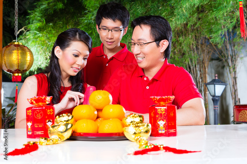 Family with Chinese new year traditional gift