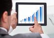 Businessman Analyzing Graph
