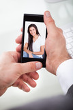 Man Having A Videochat With Woman
