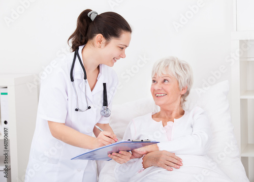 Doctor Giving Prescriptions To Patient