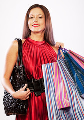 cute young woman shopping with color bags
